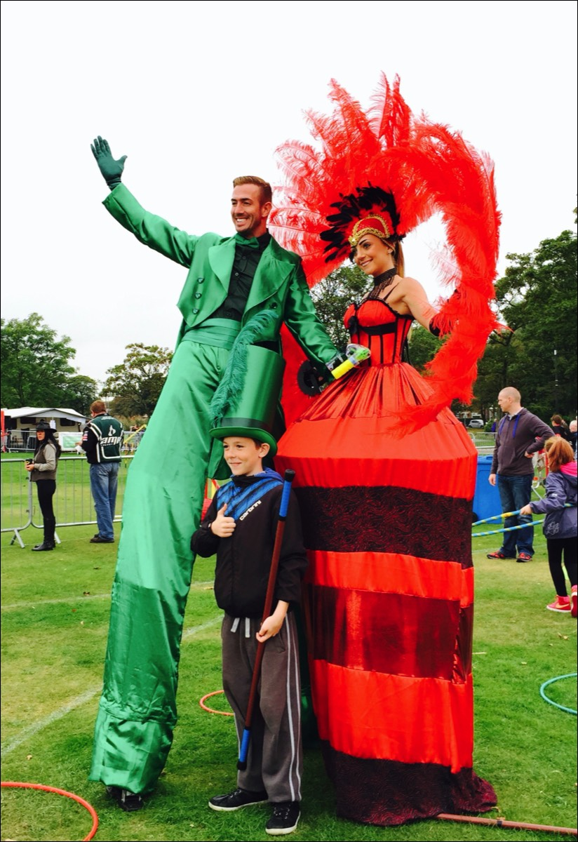 Two Stiltwalkers performing walkabout entertainment